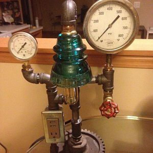 One of the lights Made by Pat Collins of Industrial Accent, the water valve turns on the light!