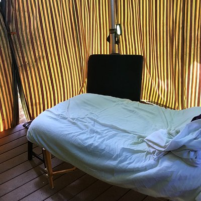 """massage table in """"beach tent"""" notice the curtains are closed all around"""