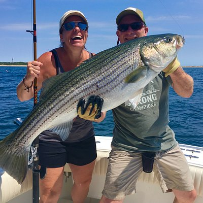 The smile says it all. A trophy Striped Bass caught off Provincetown