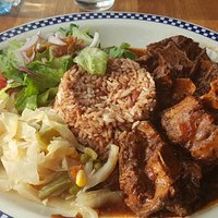 Oxtail with rice and beans and salad.
