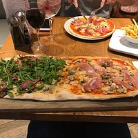 Half and half large pizza, not on the menu but they are happy to do it!