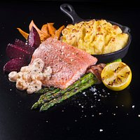 BBQ SALMON FILLET: Barbeque salmon fillet with shrimp sauce and asparagus wrapped in bacon.
