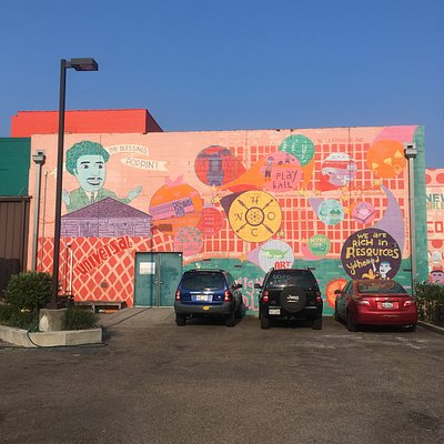 A mural on the Healing Center this is in the back parking lot.