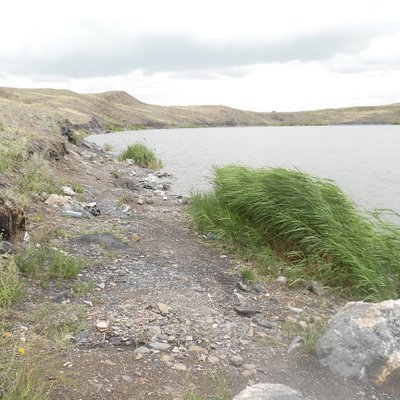 shore of lake, with evidence of campers