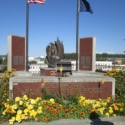Statute of President Eisenhower at the monument. Alaska State Railroad Station in background.