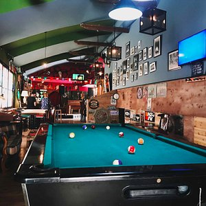 Billiards game inside the bar.