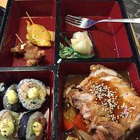 Box with duck and sushi