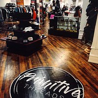 A massive retail space carrying brand-new, cutting edge clothing, shoes & accessories