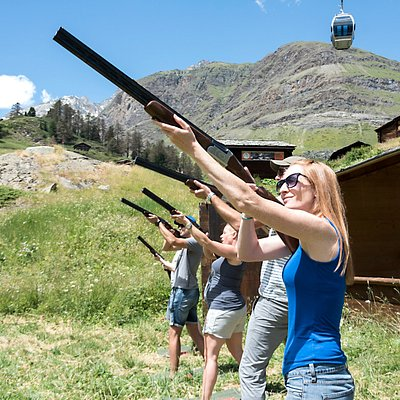 Mixed clay shooting group taking aim
