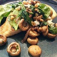 Roast button mushrooms, Udder delights goats chevre, & spinach bruchetta & hazelnut dressing