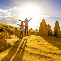 """""""Stay still and they won't see us!"""" 🙊. We had such a fun time exploring The Pinnacles in Nambung National Park!! The kids spotted a parrot, a garden gnome and a dinosaur in the huge limestone pillars that towered over us. It definitely felt like we had landed on Mars 🌚. Have you been?  The Pinnacles, Western Australia."""