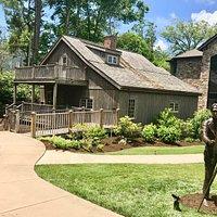 Edgewood Cottage and statue of its original owner, Elliott Daingerfield