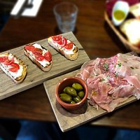 Bruschetta at left Italian Charcuterie & olives at right