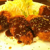 fried chicken with some demi-glace sauce
