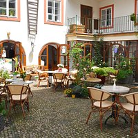 Here is our beautiful cafe courtyard oasis, far from the madding crows but right next to the bri