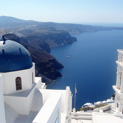 Iconic view of blue domed churches in Fira, Santorini