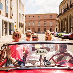 Cruise the streets in a convertible classic car in Havana