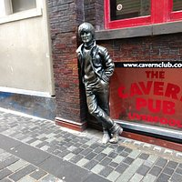 Different views of the John Lennon statue