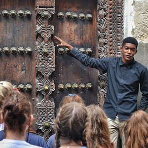Ally Jape on a tour with a group of students explaining the famous Zanzibar doors