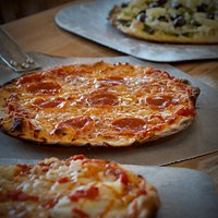 "Our pizzas are 9"", thin crust, hand-made, cooked in our wood-fired oven."