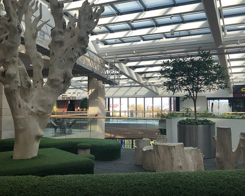Modern shopping mall with large number of fashion shops. It´s quite futuristic with many flowers