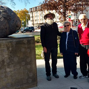 """Sculptor of """"Winter Mouse"""" with his art poses with the sponsors at Bicentennial Sculpture Park"""