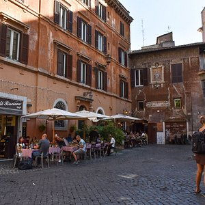 The cafe sits on a corner leading into the small square and is sometimes shaded by the buildings