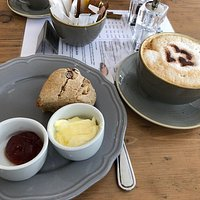 Fruit scone with clotted cream and jam
