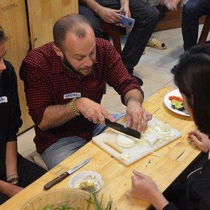 Chopping ingredients to make Phở