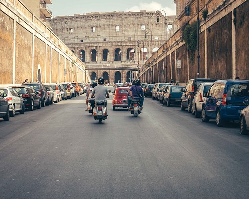 Best view of the Colosseum is from the back of our Vespa!