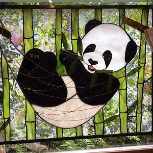 Panda in a hammock stained glass window dimensional production by Talking Turkey Studio.