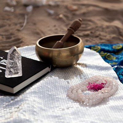 Singing bowls are a beautiful way to recharge and clear your aura/energetic field.  This particular bowl is attuned to the heart chakra, as are my rose quartz prayer beads.  The answer is love.  Photo Credit: Lisa McTiernan Photographer