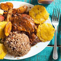 Our Caribbean Chicken, rice and beans and fried  green plantains!