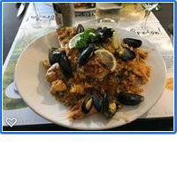 Delicious paella with lots of tasty mussels, prawns and tender octopus plus a chicken leg and thigh.  Almost too big...