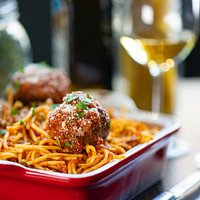 MEATBALLS AND SPAGHETTI  mama's secret meatball recipe served with the freshest pasta and a special marinara sauce. Served family style (can feed up to 5 people).
