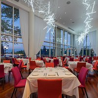 Dramatic river views and swanky design serving American Cuisine.