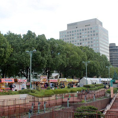 Daytime view on the day of Nagoya Matsuri showing food and game vendors.