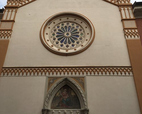 simple gabled façade with rose window