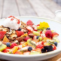 Tropical buckwheat, cacao & hempseed granola with fresh spring fruits, coconut ice-cream and coconut milk.