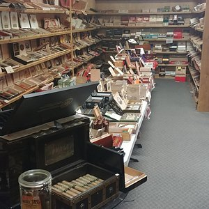 340 sq.ft. humidor packed with fine cigars. 3600 sq.ft. lounge with big screns and 2 pool tables. Music, beer, and wine. Always open late on Monday, Wednesday, and Friday. Never close before 8pm on Tues, Thurs, and Sat and often open later.