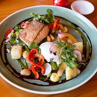 Salmon entree- char-grilled salmon, fresh asparagus and poached egg with rusa salad and cider sauce