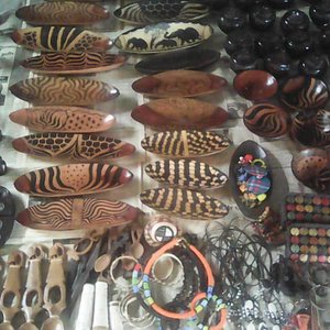 Wooden bowls, spoons, jewelry, and other carvings