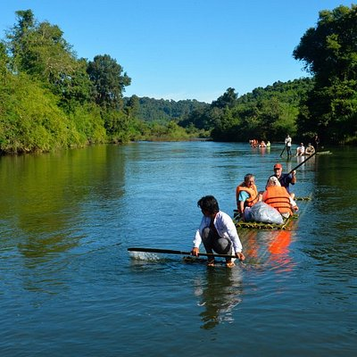 We enjoy our bamboo-rafting trip back from the jungle trekking