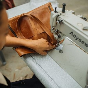 A leather handbag being made onsite.