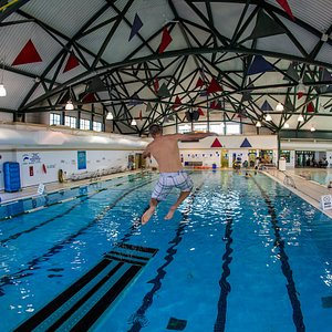 Competitive swimming pool with diving board and rope swing. Photo by Raven Eye Photo/Tourism Fernie