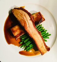 Slow roasted belly of pork with fennel seeds, pressed potato & apple, green beans with a red wine sauce. (from the to follow section)