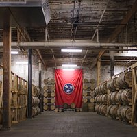 The Tennessee State flag stands guard of our precious Tennessee Whiskey.