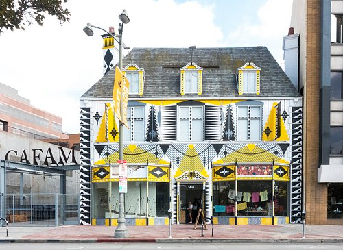 The facade of the Craft & Folk Art Museum was painted by Shrine, a Los Angeles-based artist who creates large-scale installations for art festivals around the world.