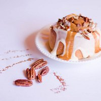 This is a delicious CARAMEL PECANS roll with our famous White Frosting