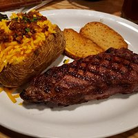 Steak and loaded baked potato
